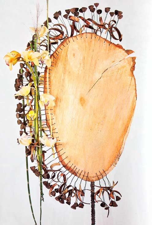 Arreglo-orquideas-tronco-eucalipto